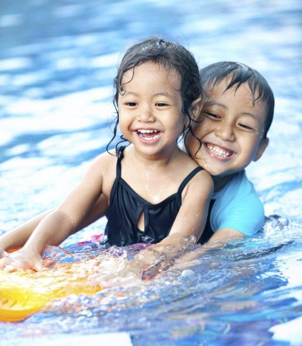 Kids playing in the pool. No pool leak repair needed.