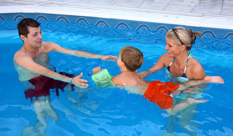 Family playing in the water. How do I know if my pool is leaking?